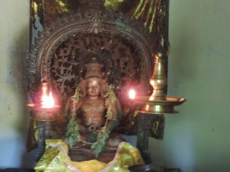 Buddha bronze in Mahayana style with the ornamental crown Ushnisha and Bodhi tree in the backdrop Prabha, now worshiped as Krishna in Kilirur temple, Kottayam.