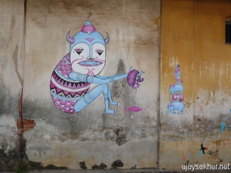 A mural on an abandoned godown wall by artists from Europe