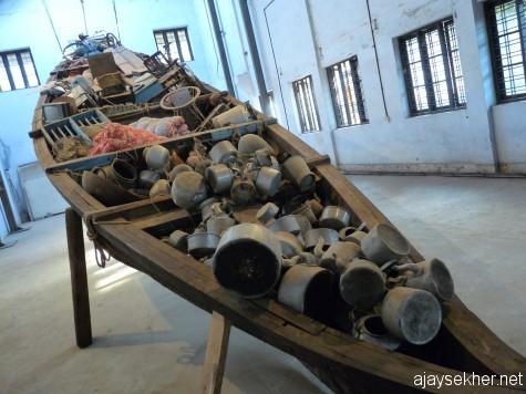 Phenomenal and awesome: Subodh Gupta's big installation using an old country boat of Kochi at Aspinwall.