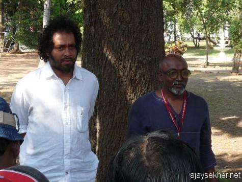 Riaz Komu and Bose Krishnamachari the curators of Biennale addressing the people at Aspinwall House.