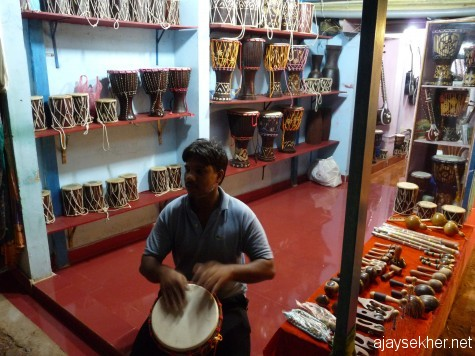 Beating the recession blues: A musician from Rajasthan selling his instruments on the cliff at Varkala.