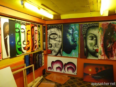 Colours of enlightenment:  Various facets of the buddha and his symbol the elephant painted by a north Indian artist in his studio gallery on the cliff at Varkala Papanasam.