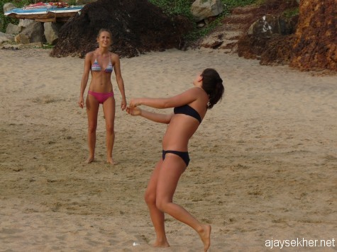 Playing Christmas: Women in action in beach volleyball at Papanasam, Varkala on 2012 Christmas day.