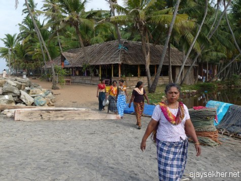 Fisher women coming for work on the morning of 26 Dec 2012. Black Beach, Varkala.