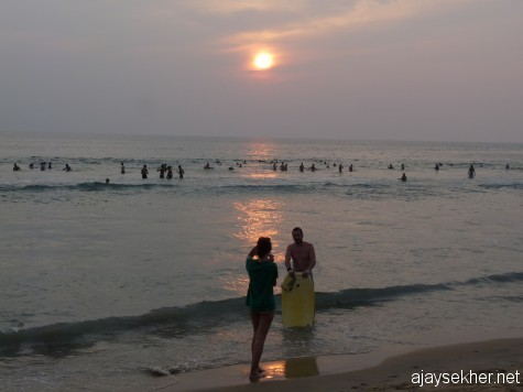 A couple from alien shores: Sunset at Papanasam beach, Varkala.  2012 Christmas comes to an end...