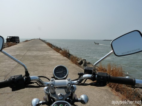 Riding into the sea.  Wave breaker or Pulimuttu at the mouth of Chaliyar that allows the Bepur port and fishing docks in Chaliyar estuary.