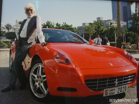 Sultan of Indian art: M F Husain with his Ferrari; a photo by Atul Dodiya.