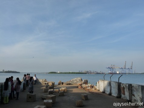 Where nature, art and people meet:  props of Sheela Gowda's stone installation projecting into the Aspinwall dock beside the ship channel in Fort Kochi.
