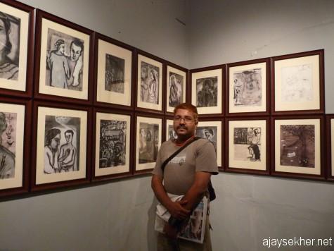 Before Prabhakaran's paintings at Aspinwall.