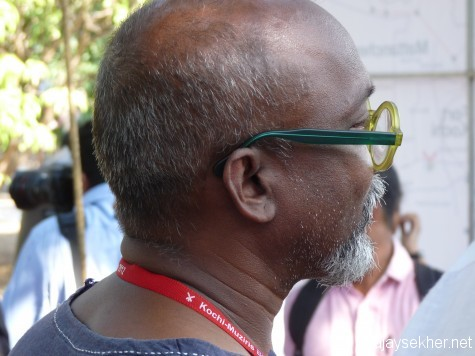 The lonliness of the hero:  Bose Krishnamachari lost in deep though amidst the crowd at Kochi Biennale 2012.