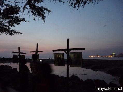 Binnale paintings on display at Fort Kochi beach walkway.