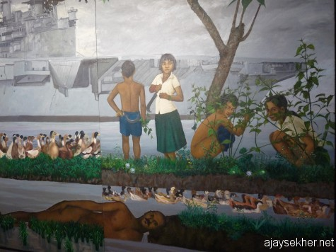 Detail from K P Reji's Thoombinkal Chathan.  See the life in the periphery still and the persistent presence of the past in the present, rendered through live imagery.