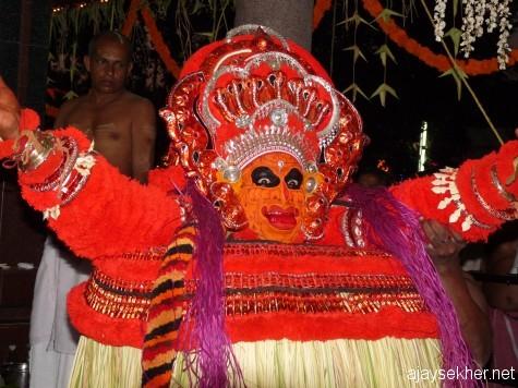 Vishnu Murti at Pulikunnu Kavu, Kasaragod, 2010.  Vishnu Murti was originally Palantayi Kannan a Tiya boy murdered by a Kurup the caste lord.  Likewise the Pottan Theyyam originally a Paraya man became an incarnation of Siva in the elite appropriation later.