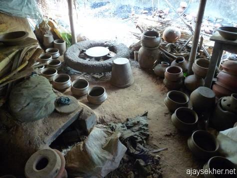 Turning the pot and tilling the land:  Potter's wheel and kiln in a Kumbhara alley in Ezhava Thuruthy by the Perar near Ponnani.