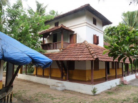 The remaining western block of the old Ettukettu at Changaram Komarath.  The blue pvc sheet thatched pagoda on the extreme left was used as an Ezhuthupally for children.