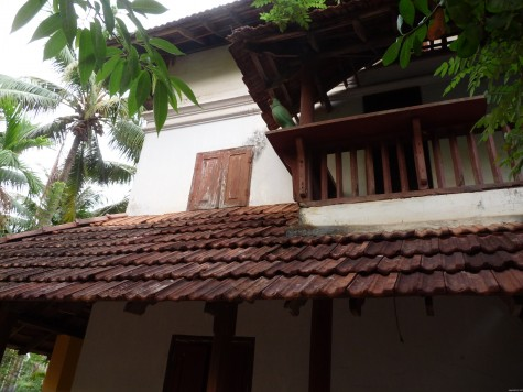 The wooden parakeet on the western balcony at Changaram Komarath house. Early April 2013.