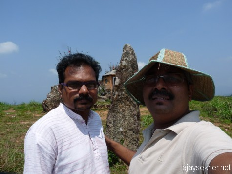 Beore the big menhir at Panjalimed with Anirudh.  A left hand self click in good morning light.