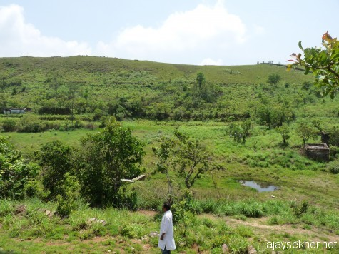 The origin of a stream in the grassland shola at Panjalimed.  It flows south west and joins the river Manimala and reaches the Vembanad.