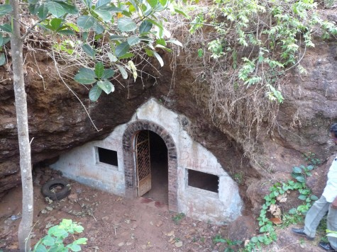 Pariyapuram Buddhist cave.  In the 1930s Bhikshu Dharmaskand installed a new marble statue of the Buddha where an old demolished Buddha idol relic was said to be placed.