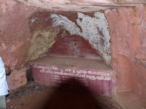 "The carved niche in which the Buddha idol was installed by Bhikhu in 1935 according to Aandi Kutty master.  ""Be Your Own Light"" the words of the enlightened is inscribed in Malayalam along with the Tri Saranas: Buddham, Sangham and Dhammam."