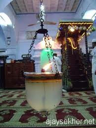 The light of Ponnani:  The hanging lamp in Ponnani Valiya Pally.  Sitting in the light of the lamp is the ritual culmination of Islamic learning in south Asia.