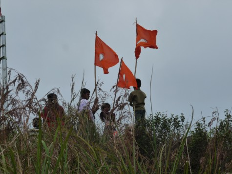 Saffron flags coming up on the Mangaladevi top, 25 apl 2013.