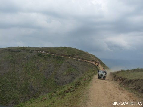Jeeps plying from Kumaly to Mangaladevi shrine through mountain roads over the grasslands on the Kerala-Tamil border.