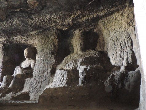 A Buddha bust in Ellora or Elapura.  Such busts were changed to the Mahes bust in Elephanta near