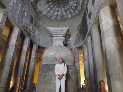 Before the Stupa in a Chaitya hall or cathedral at Ajanta.  Mark the apse, pillars and other cathedral architecture that was later recovered by European churches.