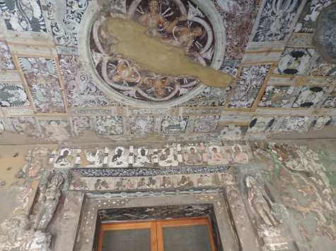 The fabric look alike Shamiana painted onto the cut ceiling  at Ajanta.