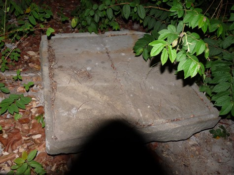 A sculpted granite plaque resembling an open book at the Nalapatt Kavu, Punnayurkulam.  It could be a pedestal or base of some other ancient idols.