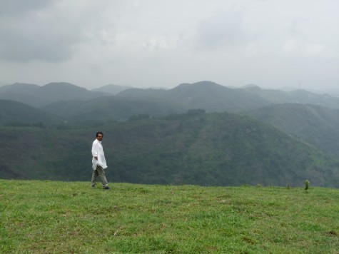 Pallykanam grasslands in Vagaman.  May 2013.  Anirudh walking through the grassland.  Also called Punjar Motta resonating the egg like top and the Stupa that once adorned the top.