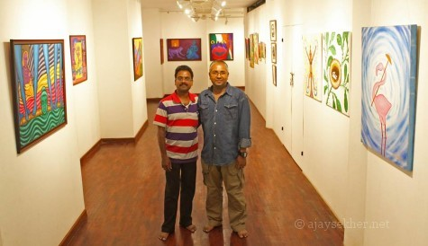 N P Jayan of Indian Express captured us together with elan at Calicut Lalitkala Akademi gallery. 23 Oct 2013.