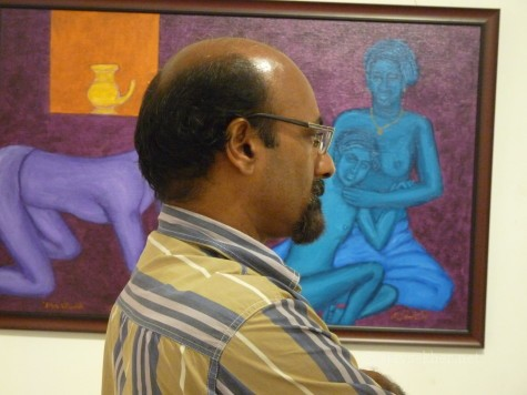 Dr Umar Tharamel lost amidst paintings in image/carnage 2 at Calicut.