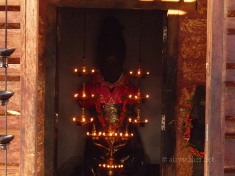 The main and big idol relic of Muruka at Trikaipata shrine Calicut.  The limbs below the knee and hands are lost.  The neck is also broken.  The face is obliterated. The head gear and ornamented hairdo clearly connects it to the Boddhisatva figures and iconography associated with Mahayana Buddhism in south India.  Murukan or Andavan was a Bala Boddhisatva before being appropriated into the Hindu Saivite pantheon as the son of Siva.