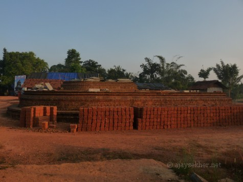 The huge apsidal (Gajaprishta) base of the northern shrine of Murukan now being rennovated.  It was rediscovered in 1992 beneath a heap of red soil.