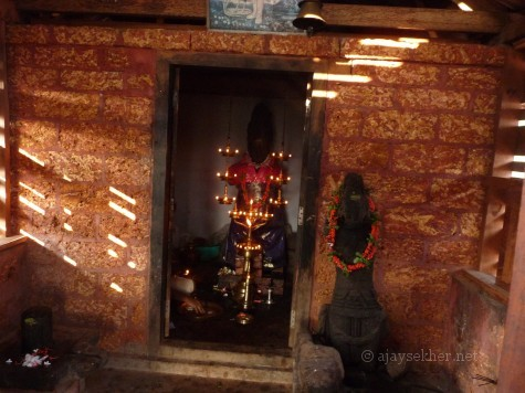The two idols lacking limbs and faces obliterated in Trikaipata temple on Ponnamkod hill, Calicut.