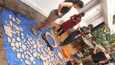 Oxford University archeologists and Kerala researchers like Mikky (right) discussing the findings at Pattanam.