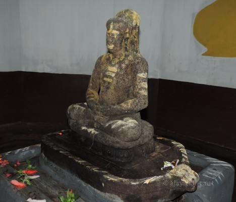 Ancient granite idol of the Buddha recovered in 1964 at Topil in Onampally.  See the Ushnisham or crown of hair, Utariyam or robe on left shoulder and Jwala or flame of enlightenment atop the hair that are the key markers of a Buddha idol.  Could be dated to 7th and 8th century AD and in early Teravada Anuradhapuram style.