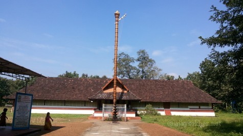Uliyanur Tevar temple; a view from east. The new metal covered concrete flag post that terminated the traditional rights of the Perum Tachan family is on the front.