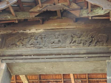 Top panel of the Anavatil or Elephant Gateway at Uliyanur Tevar temple. The relief shows figures in Padmasana and elephant motifs; two key Buddhist icons.