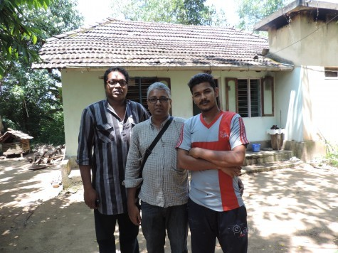 The author with Dr Aju K Narayanan and the younger member in the Perum Tachan family at Uliyanur.
