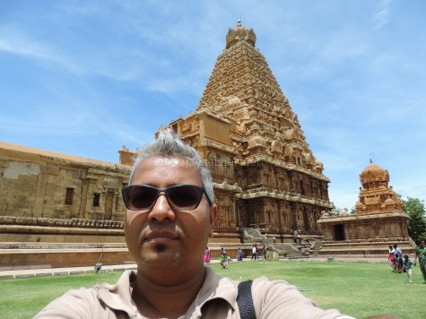 The author, Ajay Sekher in Big temple at Tanjavur. This Siva temple was built in AD 1010 by Rajaraja Chola, but it shows remarkable Buddhist connections in fresco and reliefs.