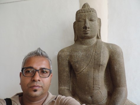 The author, Ajay Sekher with the Buddha at Tanjavur Palace Museum