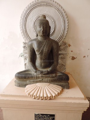 Buddha 2 at Tanjavur Palace Museum. The Mayana style hallow is added and not part of the original Teravada sculpture.