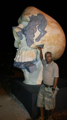 A Scull from Dalava Kulam that eats up the gate keeper: A sculpture installed at Vaikam by Sujit S N. Author of the essay Ajay Sekher before the work