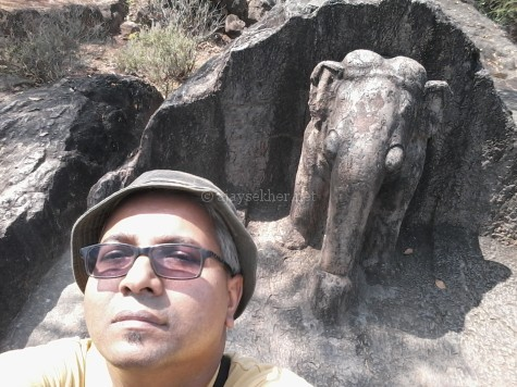Author Ajay Sekher at Dhauligiri by the Asokan elephant emerging out of the rock; Feb 2015