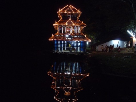 Vadayar Atuvela or river spectacle a form of Kettukazhcha on a boat near Vaikam having Buddhist carnival genealogies